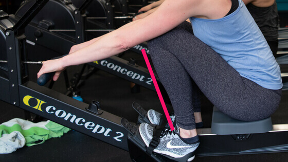 image of a rower overcompressing, with the shins past perpendicular